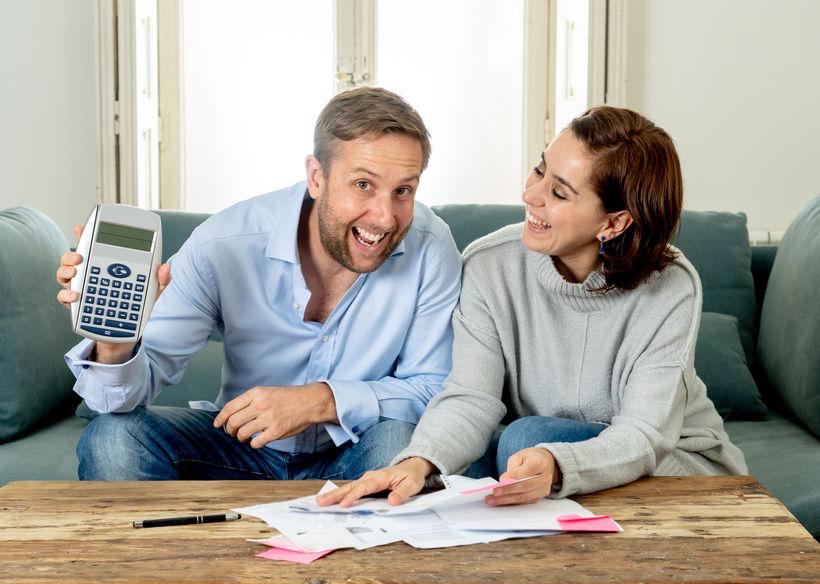 happy young couple feeling proud of finance