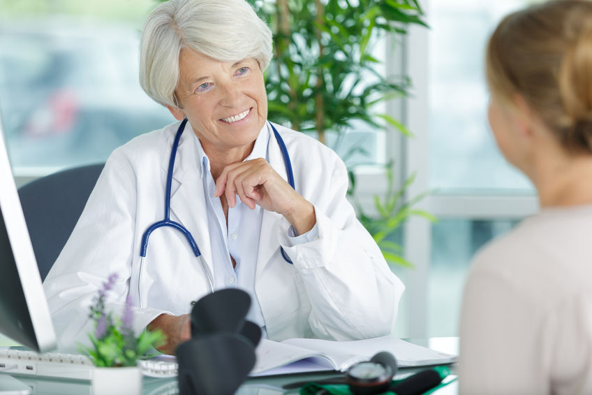 female doctor giving Social Security Disability Consultative Exam