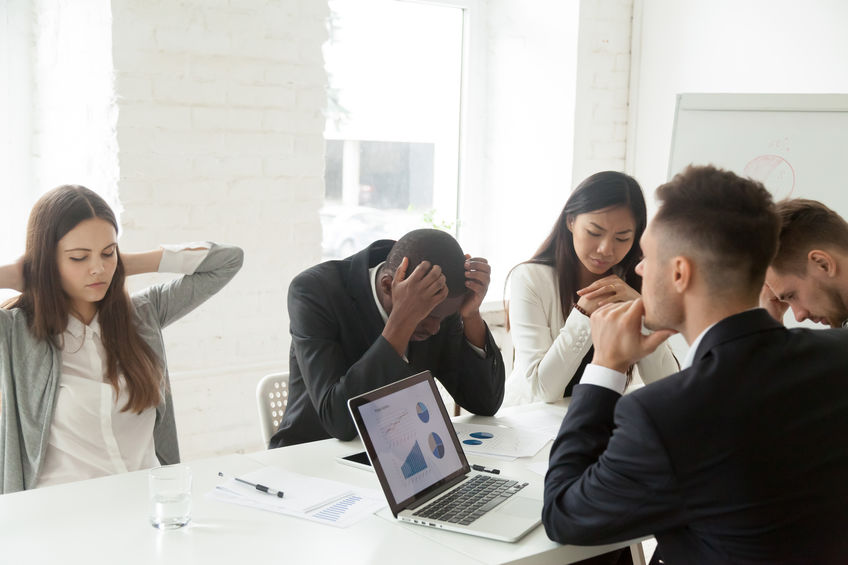 Upset colleagues feeling down because of company bankruptcy news